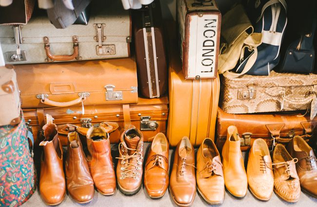 Close up of shoes and suitcases.